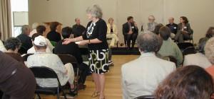 Pam Reitman greets community of mental health advocates
