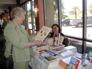 Carol Schroder  purchases Writing Career Coach Teresa's Build Your Name Beat the Game workbook from Mazelle at NCPA Conference