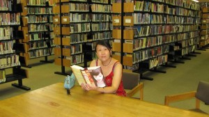 Maria reading Love Made of Heart at Boston Public Library Central Branch