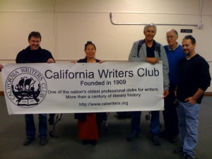 photo by Joe Jackson: Celebrating California Writers Week, Don Hudson, Writing Career Coach Teresa LeYung Ryan, Lloyd Lofthouse, Jerry Mahoney, Alon Shalev hold up California Writers Club's banner at Oakland Public Library after meeting and presentations