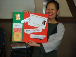 Writing Career Coach Teresa LeYung Ryan happy with her 2011 vision board collage photo by Creativity Mentor Mary E. Knippel