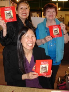 Teresa LeYung Ryan & Lakshmi Kerner cheer for Margie Yee Webb at her book launch