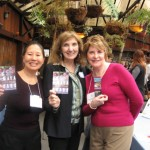Teresa LeYung Ryan & Judith Marshall  cheer for Mary Jo McConahay (middle)