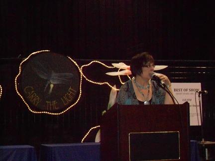 http://lovemadeofheart.com/blog/wp-content/uploads/2012/06/Bardi-Rosman-Koodrin-welcomes-audience-to-Literary-Arts-stage-San-Mateo-County-Fair-2012-photo-1-by-Coach-Teresa.jpg