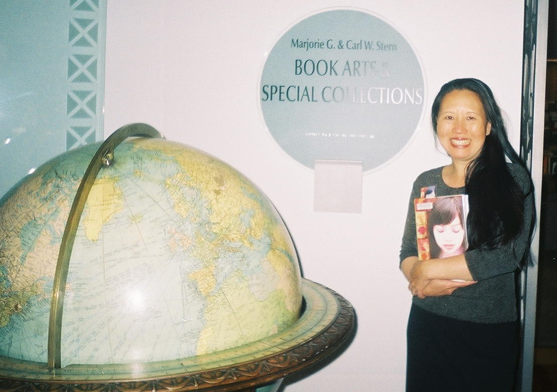 author Teresa LeYung-Ryan overjoyed - her book archived at the San Francisco History Center - photo by Elisa Sasa Southard
